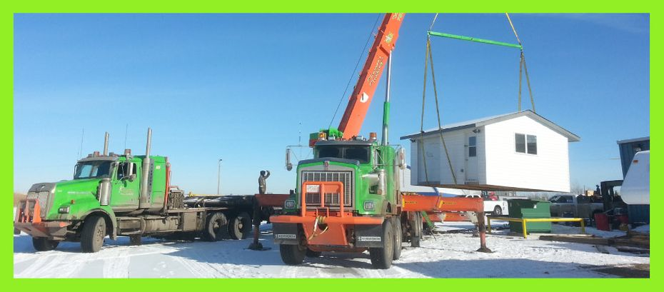 Picker truck lifting small building