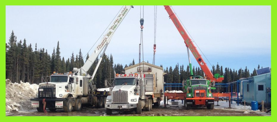 Picker trucks lifting and placing building