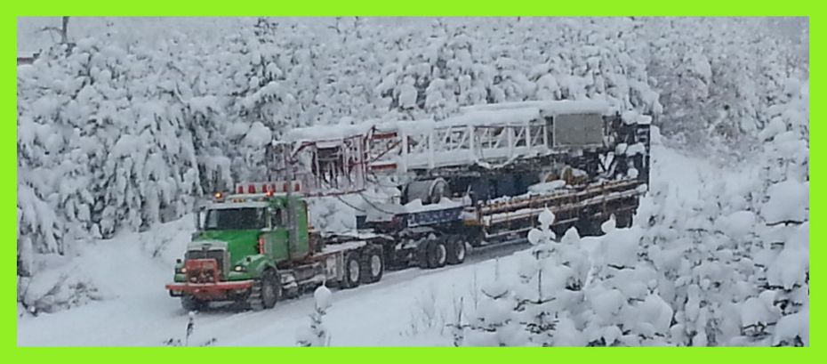 Heavy equipment hauling in snow